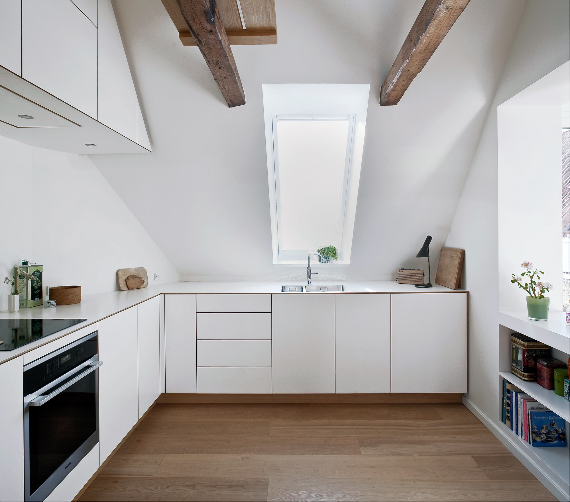 Scandinavian kitchen design in oak wood and white laminate